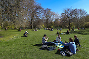 People are seen enjoying the sunny weekend with their friends and loved ones in St James' Park, Central London on Saturday, April 17, 2021. England welcomed the return of outdoor drinking and dining on Monday, but the easing of lockdown was also met with concerns about a lack of social distancing, and a wider sense of nervousness within the hospitality sector as businesses tried to operate at a significantly lower capacity and with some confusion over the rules. Millions of people in England will get their first chance in months for haircuts, casual shopping and restaurant meals this week, as the government takes the next step on its lockdown-lifting road map. (Photo/ Vudi Xhymshiti)