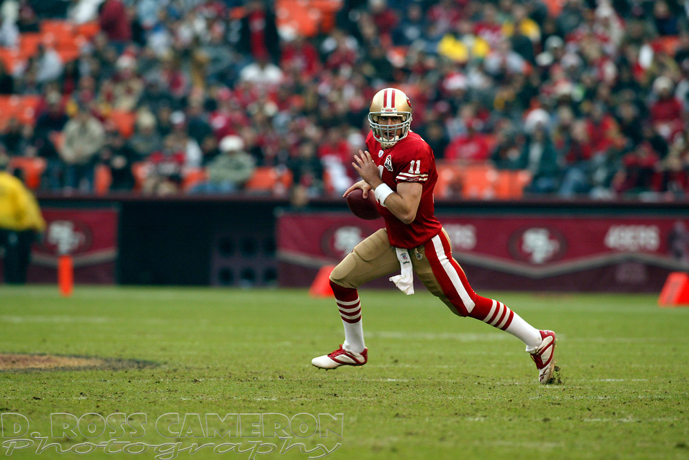 San Francisco 49ers quarterback Alex Smith (11) rolls out against the Arizona Cardinals during the third quarter of an NFL football game, Sunday, Dec. 24, 2006 at Candlestick Park in San Francisco. The Cardinals won, 26-20. (D. Ross Cameron/The Oakland Tribune)