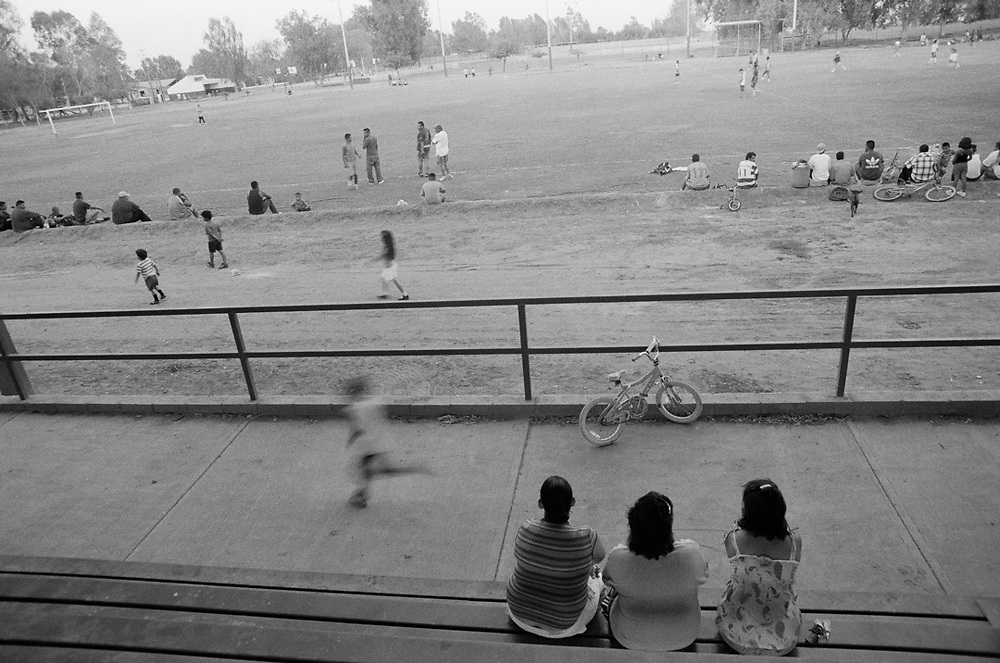 Kids gather to play soccer and hang out in the afternoon.
