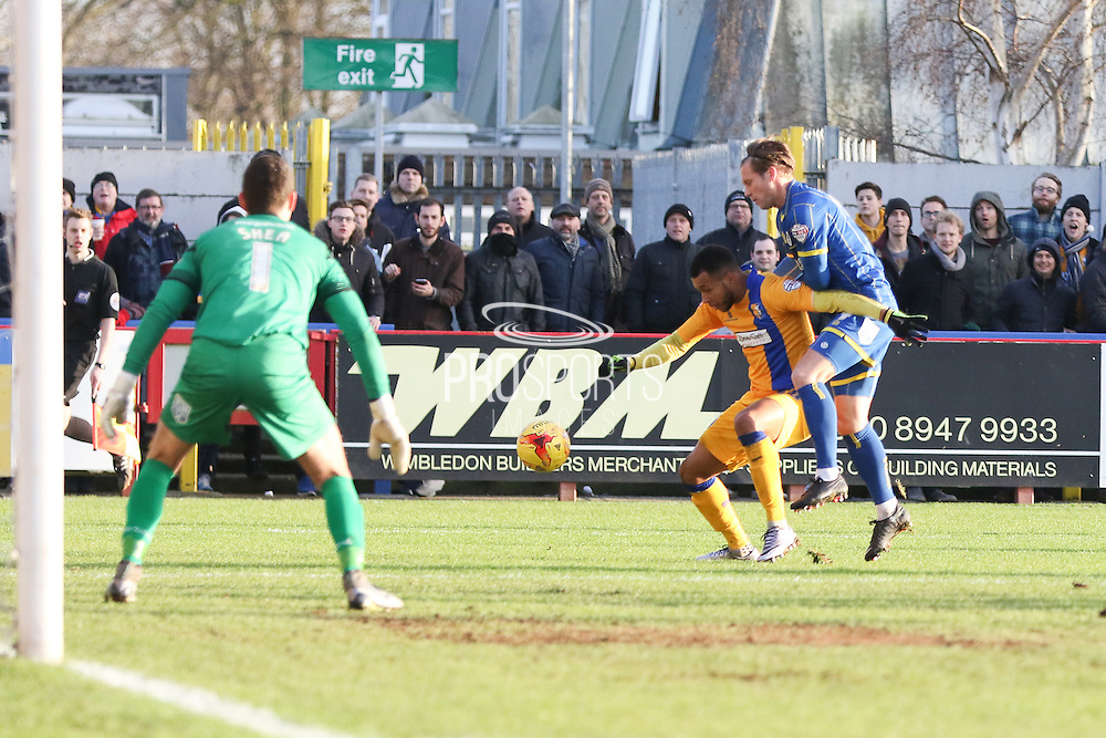 Matt Green of Mansfield Town shield the ball from Dannie Bulman of AFC Wimbledon during the Sky Bet League 2 match between AFC Wimbledon and Mansfield Town at the Cherry Red Records Stadium, Kingston, England on 16 January 2016. Photo by Stuart Butcher.