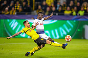 Tottenham Hotspur defender Davinson Sánchez (6) tackles Borussia Dortmund forward Paco Alcácer (9) during the Champions League round of 16, leg 2 of 2 match between Borussia Dortmund and Tottenham Hotspur at Signal Iduna Park, Dortmund, Germany on 5 March 2019.
