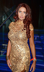 AMY CHILDS at a party hosted by Beats by Dre to celebrate the launch of Tinie Tempah's new album and to celebrate his birthday held at DSTRKT, Rupert Street, London on 7th November 2013.