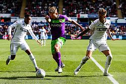 Andreas Weimann of Bristol City is challenged by Joe Rodon ands Martin Olsson of Swansea City - Rogan/JMP - 25/08/2018 - Liberty Stadium - Swansea, Wales - Swansea City v Bristol City - Sky Bet Championship.