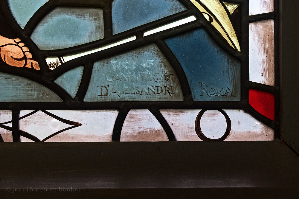 The signature appears to be both scratched into the glass and painted. <br />