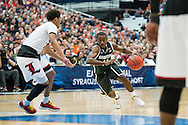 29 MAR 2015: Lourawis Nairn Jr. (11) of Michigan State University drives in to the paint against Quentin Snider (2) of the University of Louisville during the 2015 NCAA Men's Basketball Tournament held at the Carrier Dome in Syracuse, NY. Michigan State defeated Louisville 76-70 to advance. Brett Wilhelm/NCAA Photos