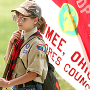 Maumee resident Maegan Reynolds, 12, holds the Scouts BSA troop 103 flag as she walks in the parade for the Lucas County Fair in Maumee, Ohio, on Monday, July 8, 2019. Reynolds is in troop 9103, the girl troop based out of Maumee. THE BLADE/KURT STEISS