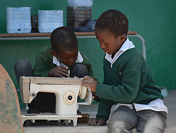 Nov. 21, 2014 - Mthatha, Eastern Cape, South Africa - School boys play with sewing machine in  Mandela's homeland of Mthatha. Mthatha, Eastern Cape, South Africa. (Picture by: Artur Widak/NurPhoto) (Credit Image: © Artur Widak/NurPhoto/ZUMA Wire)