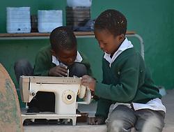 Nov. 21, 2014 - Mthatha, Eastern Cape, South Africa - School boys play with sewing machine in  Mandela's homeland of Mthatha. Mthatha, Eastern Cape, South Africa. (Picture by: Artur Widak/NurPhoto) (Credit Image: © Artur Widak/NurPhoto/ZUMA Wire)