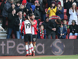 Southampton's Charlie Austin (right) celebrates scoring his side's first goal with team-mate Sofiane Boufal during the Premier League match at St Mary's, Southampton.