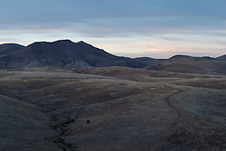 Sunset on folded hills of Grand View, Ladder Ranch, west of Truth or Consequences, New Mexico, USA.
