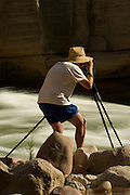 Photographer Ralph Lee Hopkins (release on file) photographs rapids of the Colorado River, Grand Canyon National Park, Arizona, US