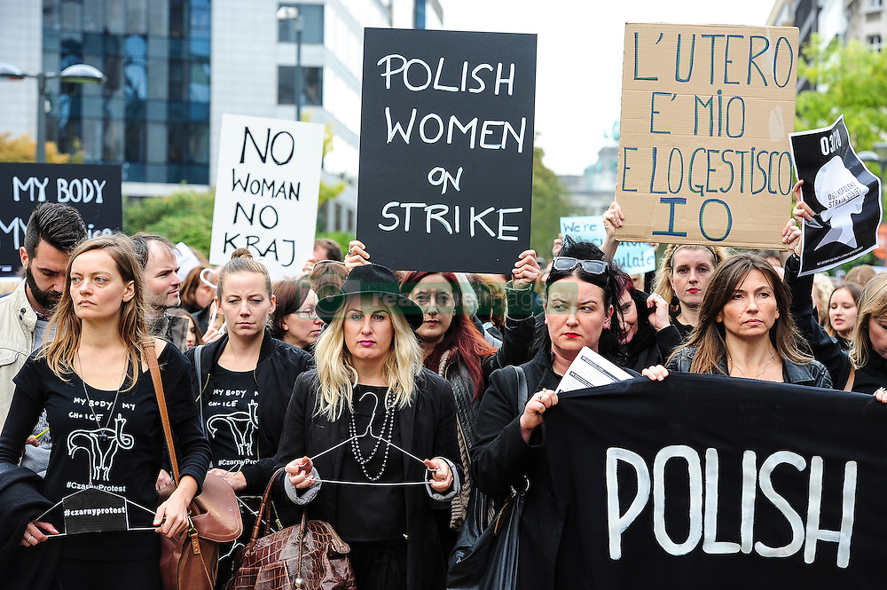 October 3, 2016 - Brussels, Belgium - Polish women hold the Black Protest ( Czarny Protest )  against planned ban on abortion. About 500 Polish workers of EU institutions gathered at European quarters in Brussels, Belgium to demonstrate against  an effort to criminalize abortion in Poland. (Credit Image: © Wiktor Dabkowski via ZUMA Wire)