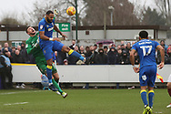 AFC Wimbledon midfielder Liam Trotter (14) battles for possession with Northampton Town goalkeeper Richard O'Donnell (13) during the EFL Sky Bet League 1 match between AFC Wimbledon and Northampton Town at the Cherry Red Records Stadium, Kingston, England on 10 February 2018. Picture by Matthew Redman.