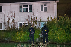 © Licensed to London News Pictures. 02/12/2019. Loughton, UK. Armed police stand guard after a house on Hatfields was searched whilst looking for suspect Terry Glover.<br /> A murder investigation has been launched after a 12-year-old boy died and a number of other pedestrians were injured during a hit-and-run incident near a school on Wallingale Road, Loughton. Photo credit: Peter Manning/LNP