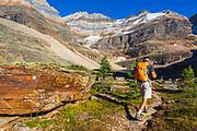 Hiker on the Yukness Ledges Trail at Lake Oesa, Yoho National Park, British Columbia, Canada