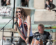 05 November 2012:  Aerosmith's Steven Tyler and drummer Joey Kramer perform a free concert in Boston's Allston neighborhood in front of the apartment building, 1325 Commonwealth Ave, which was the band's home in the early 1970's.  Boston, MA. ***Editorial Use Only*****
