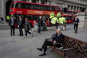 Two officers on horses with the mounted City Police, patrol Conhill and the Bank of England, in the City of London, the capital's financial district, on 14th March 2018, in London England.