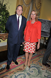 The EARL & COUNTESS OF DARTMOUTH at Ambassador Earle Mack's 60's reunion party held at The Ritz Hotel, London on 18th June 2012.