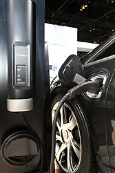 12 February 2015:  2015 CADILLAC ELR I(shown charging): The 107th annual Chicago Auto Show, Feb. 14-22, 2015, becomes the third year that the sleek Cadillac ELR electric vehicle luxury coupe has been displayed in the Windy City. It's the first application of an extended-range electric vehicle technology by a full-line luxury automotive brand. The Cadillac ELR has an aggressive, forward-leaning profile that introduces a new, progressive theme and proportion in Cadillac's design evolution. The overall shape is reinforced by a prominent, sweeping body line accented by 20-inch wheels pushed to the edges of the body. Making the ELR a standout are the light-emitting diode (LED) headlamps, daytime running lamps and taillamps, as well as signature front and rear lighting elements. Inside, the ELR's classic 2+2 layout is driver focused and fitted with leather-trimmed cockpit that blends authentic chrome and wood accents – and available carbon fiber trim – as well as a sueded microfiber headliner and steering wheel covered in leather and sueded microfiber. True engineering marvels power the ELR, combining pure electric drive and an efficient, range-extending 1.4L gasoline-powered electric generator capable of 207 horsepower of total system power. Using only the energy stored in the battery, the ELR delivers a range of about 35 miles of pure electric driving. The premium Bose 10-channel audio system with active noise cancellation is standard equipment.  For the record, the ELR design is almost unchanged from the Converj concept that was a hit at the '09 Chicago show.<br /> <br /> First staged in 1901, the Chicago Auto Show is the largest auto show in North America and has been held more times than any other auto exposition on the continent. The 2015 show marks the 107th edition of the Chicago Auto Show. It has been  presented by the Chicago Automobile Trade Association (CATA) since 1935.  It is held at McCormick Place, Chicago Illinois