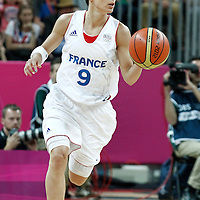 30 July 2012: Celine Dumerc of France brings the ball upcourt during the 74-70 Team France overtime victory over Team Australia, during the women's basketball preliminary, at the Basketball Arena, in London, Great Britain.
