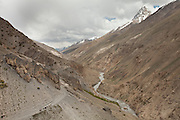 A yak caravan making its way up a dangerous pass. Trekking up and along the Wakhan river, the only way to reach the high altitude Little Pamir plateau, home of the Afghan Kyrgyz community.