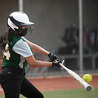 Thoreau's KC Curley connects with the ball during their varsity softball game against Rehoboth Thursday at Ford Canyon Park in Gallup.