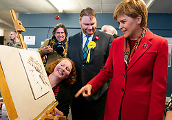 Dalkeith, Scotland, UK. 5th November 2019. First Minister Nicola Sturgeon joined Owen Thompson, SNP candidate for Midlothian, to campaign in Dalkeith at the One Dalkeith Community Hub where she met local artists and musicians. Nicola Sturgeon chats to local artist about her work. Iain Masterton/Alamy Live News.
