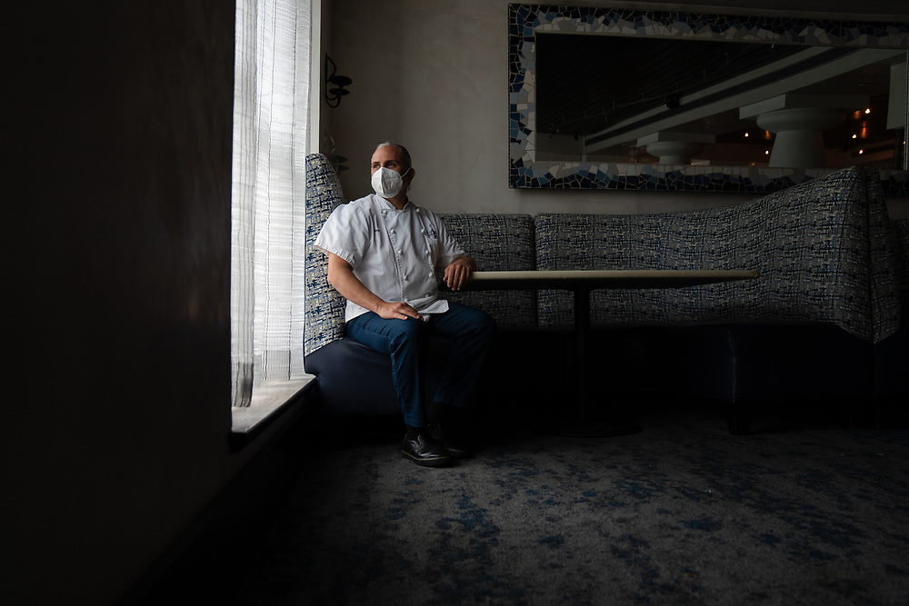 Pano Karatassos, corporate chef at Kyma restaurant in Atlanta, poses for a portrait there on Thursday, April 23, 2020. Brian Kemp, the Republican governor of Georgia, announced earlier this week that restaurants and several other service industry businesses could reopen on Friday, April 24. This comes despite the warnings of health and epidemiology experts that a spike in coronavirus cases is very likely.<br /> <br /> Mr. Karatassos, who operates several restaurants in Atlanta, plans on opening a few eateries next Thursday,  April 30, but will wait about three weeks to open Kyma.<br /> <br /> Photo by Kevin D. Liles for The New York Times https://nyti.ms/2W4AMU5