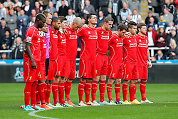Liverpool players stand during a minutes silence for rememberance day - Photo mandatory by-line: Rogan Thomson/JMP - 07966 386802 -01/11/2014 - SPORT - FOOTBALL - Newcastle, England - St James' Park - Newcastle United v Liverpool - Barclays Premier League.