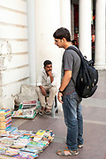 A man peruses magazines on a street stall in Connaught Place, New Delhi.