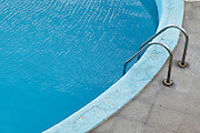 edge of a swimming pool on a greyish day