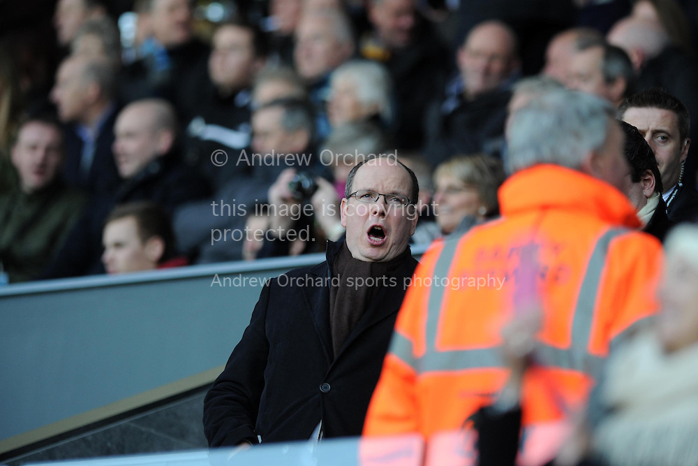 Prince Albert of Monaco watches the match from the stand and happily sings along with the Swansea fans. Barclays premier league match, Swansea city v Sunderland at the Liberty stadium in Swansea, South Wales on Saturday 7th Feb 2015.<br /> pic by Andrew Orchard, Andrew Orchard sports photography.