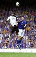 Photo: Greig Cowie.<br /> 23/08/2003.<br /> FA Barclaycard Premiership. Everton v Fulham. Goodison Park.<br /> Louis Saha heads with David Unsworth