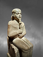"""Ancient Egyptian statue of Ptah - limestone - New Kingdom. 18th Dynasty, reign of Amenhotep III (1390 - 1353 BC), Karnac. Egyptian Museum, Turin.  Grey background<br /> <br /> Large statue of Egyptian gods are rare and most of them are part of building designs. This imposing statue of Ptah was probably made for the """"Temple of Millions of Years"""", on the west bank of Thebes, promoted by Amenhotep III . When the temple was eventually abandoned its statues were reused in other temples in the region. Drovetti collection C. 87 .<br /> <br /> If you prefer to buy from our ALAMY PHOTO LIBRARY  Collection visit : https://www.alamy.com/portfolio/paul-williams-funkystock/ancient-egyptian-art-artefacts.html  . Type -   Turin   - into the LOWER SEARCH WITHIN GALLERY box. Refine search by adding background colour, subject etc<br /> <br /> Visit our ANCIENT WORLD PHOTO COLLECTIONS for more photos to download or buy as wall art prints https://funkystock.photoshelter.com/gallery-collection/Ancient-World-Art-Antiquities-Historic-Sites-Pictures-Images-of/C00006u26yqSkDOM"""