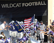 The Kansas State Wildcats roll out of the locker room lead by Terry Petrie (26) and Zach Diles (52) before playing Marshall, at Bill Snyder Family Stadium in Manhattan, Kansas, September 16, 2006.  The Wildcats beat the Thundering Herd 23-7.