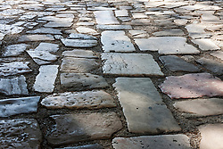 Cobblestone covered with old paving stones, Lisbon, Portugal
