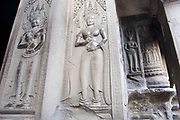 Intricate carving reliefs of Apsara dancers at Angkor Wat. This jewel in the crown of Angkor's ancient temples is a vision of beauty, might and Khmer architectural excellence. The five towers dominate the view, which you are led to trough outer walls, along causeways over the moat and past the two giant pools which act as a mirror of the vision. Consecrated at around 1150 to the Hindu god, Vishnu it is suggested that construction took 30 years.