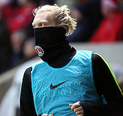 Charlton Athletic striker Simon Makienok is feling the cold during the Sky Bet Championship match between Charlton Athletic and Leeds United at The Valley, London, England on 12 December 2015. Photo by Matthew Redman.