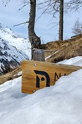 THEMENBILD - Schneebedecktes Schild Nationalpark Hohe Tauern Aussenzone am Montag, 5. April 2021. //Snow covered sign Hohe Tauern National Park outdoor zone on Monday, April 5, 2021. Kals, Austria. EXPA Pictures © 2021, PhotoCredit: EXPA/ Johann Groder
