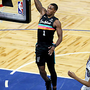 ORLANDO, FL - APRIL 12: Lonnie Walker IV #1 of the San Antonio Spurs attempts a slam dunk against the Orlando Magic during the first half at Amway Center on April 12, 2021 in Orlando, Florida. NOTE TO USER: User expressly acknowledges and agrees that, by downloading and or using this photograph, User is consenting to the terms and conditions of the Getty Images License Agreement. (Photo by Alex Menendez/Getty Images)*** Local Caption *** Lonnie Walker IV