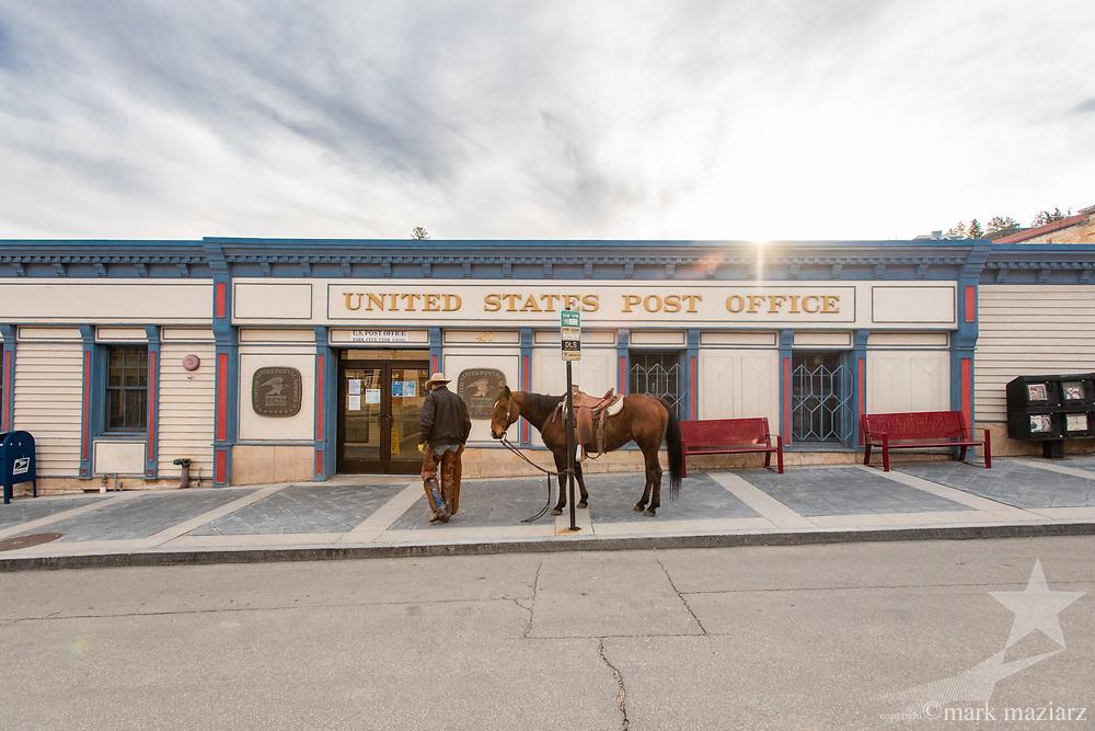 Cowboy Jim Ayers checking his mail at Old Town Post Office, Main Street, Park City UT.