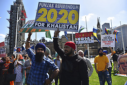 April 18, 2018 - London, England, United Kingdom - Member of various groups join together in protesting both against and in favour of India's Prime Minister Narendra Modi and discrimination against religious minorities, on the sidelines of the Commonwealth Heads of Government meeting (CHOGM), London on April 18, 2017. (Credit Image: © Alberto Pezzali/NurPhoto via ZUMA Press)