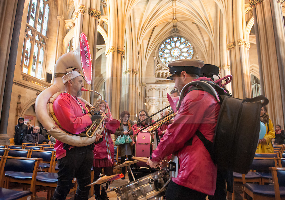 """© Licensed to London News Pictures. 10/12/2016. Bristol, UK. The Ambling Band play in Bristol Cathedral as Bristol is asked to Embrace Diversity on International Human Rights Day, welcoming humanity and diversity and building stronger communities to resist racism in Bristol as the focus of key events commemorating International Human Rights Day on Saturday 10th December 2016. There was a Sanctuary Walk from the Malcolm X Community Centre in St Pauls, headed by representatives of all Bristol's civic leaders, through the city centre to Bristol Cathedral. The two part event was organised by Bristol City of Sanctuary and local charity Bristol Refugee Rights. Revd Richard McKay, Chair of Bristol City of Sanctuary says, """"This walk will send out a clear message that Bristol is a City of Sanctuary and that we welcome refugees and asylum seekers in our beautiful city. We are walking to show welcome to those seeking sanctuary in our city. We are walking to join with other proud Bristolians to say that we are a city of diversity that treasures human rights."""" Photo credit : Simon Chapman/LNP"""