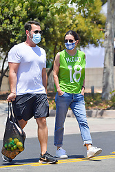 """EXCLUSIVE: Courteney Cox wears a jersey type shirt with her boyfriend's last name """"MCDAID"""" written on it. Courteney, who has been separated from her boyfriend Johnny Mcdaid since the beginning of the pandemic, stepped out in Malibu at a farmer's market with a friend and wore a shirt to show that she was thinking of her man. 05 Jul 2020 Pictured: Courteney Cox. Photo credit: Snorlax / MEGA TheMegaAgency.com +1 888 505 6342"""
