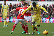 Magaye Gueye pushes past Todd Kane and Chris Burke during the Sky Bet Championship match between Nottingham Forest and Millwall at the City Ground, Nottingham, England on 31 January 2015. Photo by Jodie Minter.