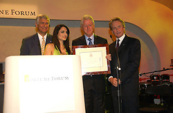 Left to right, SIR NICHOLAS YOUNG,  RENU MEHTA,  BILL CLINTON and MICHAEL DOUGLAS at the Fortune Forum Dinner held at Old Billingsgate, 1 Old Billingsgate Walk, 16 Lower Thames Street, London EC3R 6DX<br /><br />NON EXCLUSIVE - WORLD RIGHTS