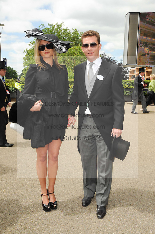 HOLLY VALANCE and NICK CANDY at the first day of the 2010 Royal Ascot Racing festival at Ascot Racecourse, Berkshire on 15th June 2010.