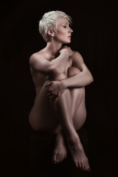 Classic nude pose by beautiful woman