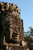 Bayon Lokesvara - The Bayon's most distinctive feature is the array of serene and massive stone faces on the many towers which jut out from the upper terrace and cluster around its central peak. The temple is known also for two impressive sets of bas-reliefs, which present an unusual combination of mythological, historical, and mundane scenes.