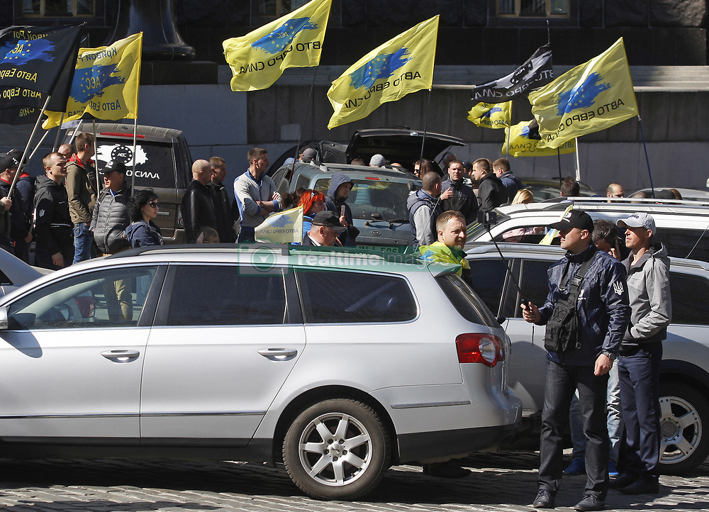 April 18, 2018 - Kiev, Ukraine - Ukrainian protesters hold flags during their meeting in front of Cabinet of Ministers in Kiev, Ukraine, on 18 April 2018. Activists gathered to protest against increasing of prices for fuel after possibility government decision about quotas for export of it. (Credit Image: © Serg Glovny via ZUMA Wire)